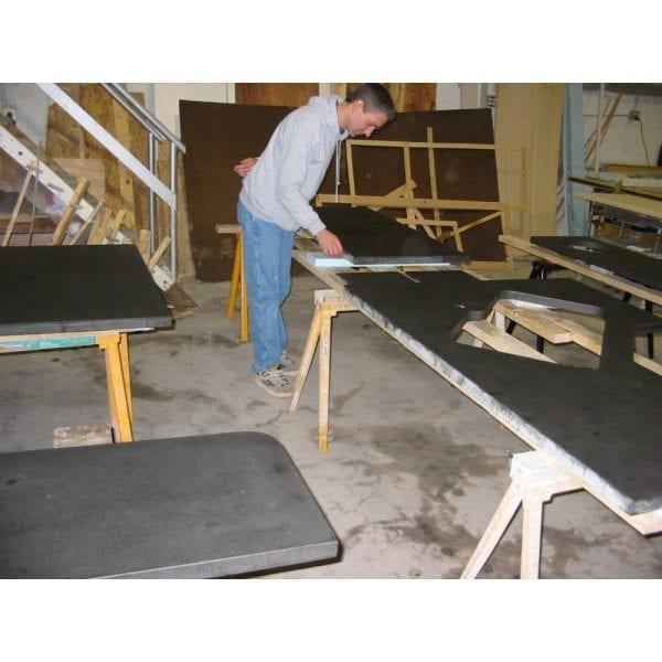 inspecting concrete countertop slabs in shop