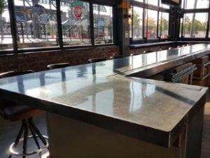 glossy gray concrete bartop in restaurant by Ramcrete Oklahoma