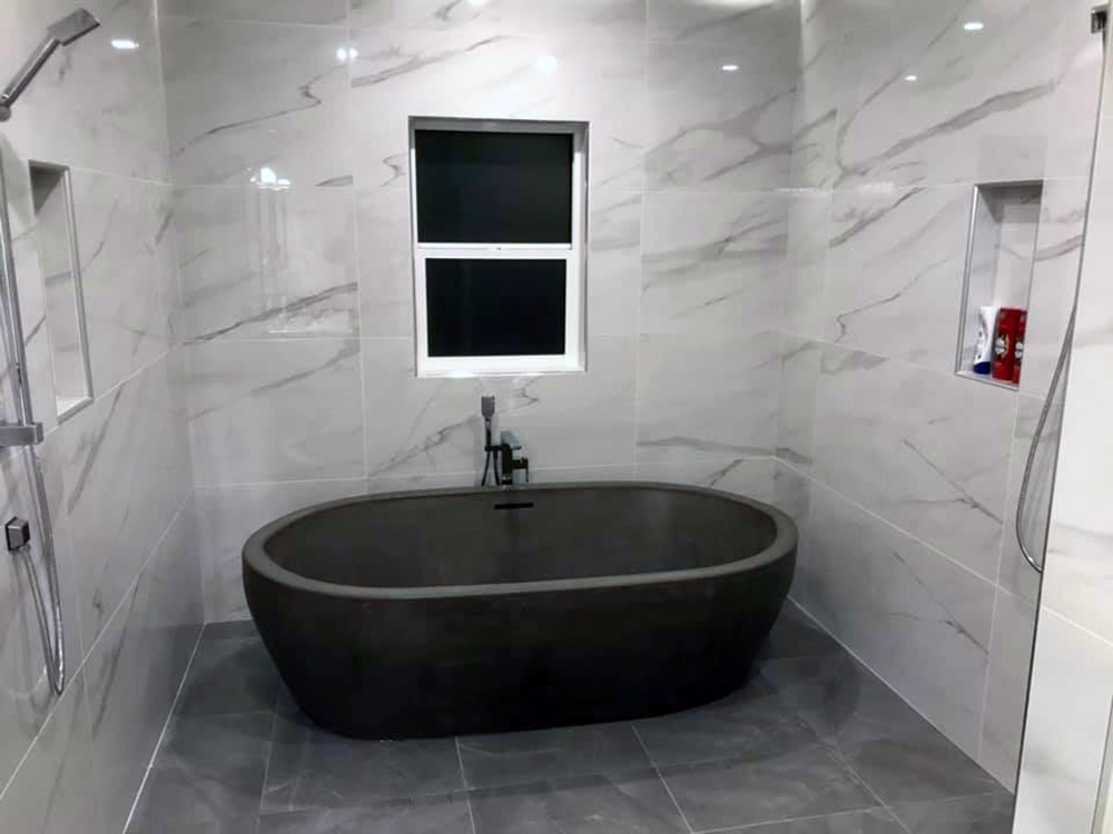 concrete tub and marble tile by Diamond Finish Concrete