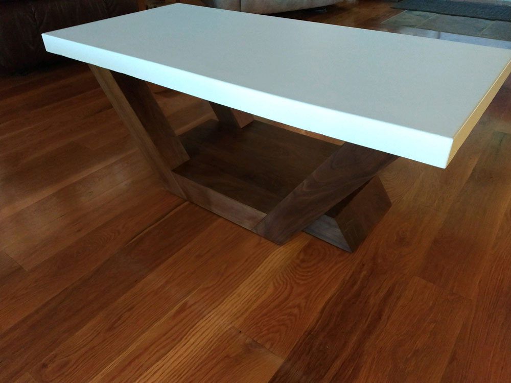 coffee table with concrete top and angled wood base
