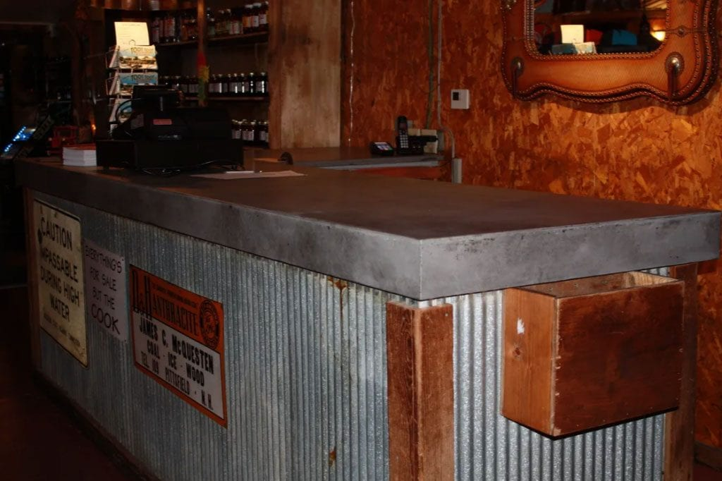 Restaurant concrete countertop in natural gray with black accents. 4 1/2 inch drop edge.