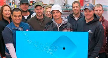people holding bright blue concrete sink